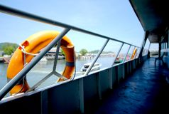 Orange Lifebuoy on ferry boat. To the sea for safety first Royalty Free Stock Images