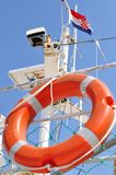 Orange lifebuoy hanging on ship with Croatian flag Royalty Free Stock Photography