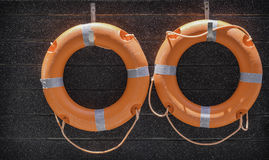 Orange lifebuoy hanging on the wall. At the pool Stock Image