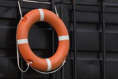 Orange lifebuoy hanging on the wall. Of a rescue station on a beach in Estonia stock photos