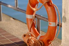 Orange lifebuoy, insure your life Stock Image