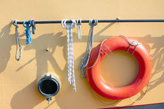 Orange lifebuoy on metal ship Royalty Free Stock Images