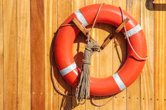 Orange lifebuoy on old sailing ship Royalty Free Stock Photography