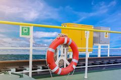 Orange Lifebuoy. In a stormy blue sky and blue sea background Stock Photos