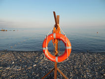 Orange lifebuoy on a pebble beach at the Black Sea Stock Photography