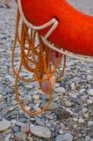 Lifebuoy on a sea beach. Orange lifebuoy on a pebbly sea beach, sunset Royalty Free Stock Images