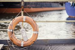 Orange lifebuoy on the pier. Copy space. Living stock images