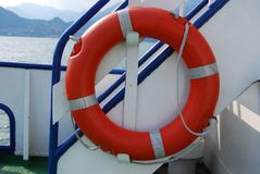 Orange lifebuoy ring on a ship Royalty Free Stock Image