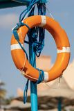 Orange Lifebuoy with Ropes on Lifeguard Chair royalty free stock image
