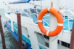 Orange lifebuoy, safety equipment, at the pier.  Royalty Free Stock Photos