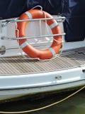 Orange lifebuoy. In sailing ship Stock Photos
