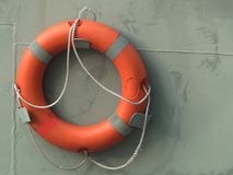 Orange lifebuoy on wall Royalty Free Stock Images