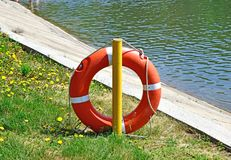 Orange lifeline near the water. The lifeline`s on the hook. royalty free stock photography