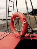 Orange lifesaver at the beach Stock Image