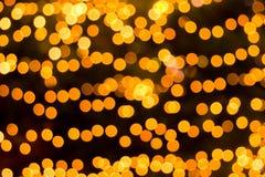 Orange light bokeh on blue background Royalty Free Stock Photo