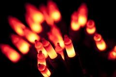 Orange light bulb. A string of orange light bulbs on black stock photos