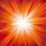 Orange light burst with sparkling stars Royalty Free Stock Photos
