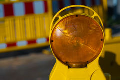 Orange light in construction. Close-up Royalty Free Stock Photo