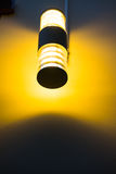 Orange light from the lamp on the wall Royalty Free Stock Photos