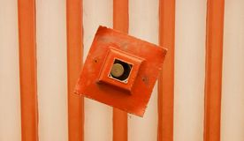 An orange light shade with exposed beams royalty free stock image
