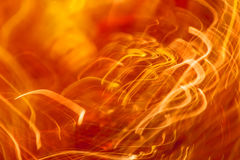 Orange light streaks Stock Photos