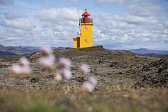 Orange Lighthouse. A lighthouse in a lava field in Grindavik, Iceland Royalty Free Stock Photography