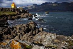 Orange Lighthouse. A lighthouse in a Djupivogur, Iceland Stock Photos