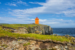 Orange lighthouse at the cost of Grimsey island nearby Iceland, Stock Photography