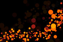Orange lights on a black background Royalty Free Stock Images
