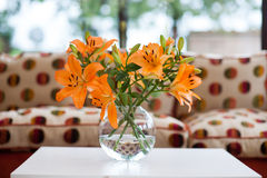 Orange lilies in a vase Stock Photo