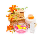 Orange lily flowers, boxes, sea salt, candles, soap  and objects Royalty Free Stock Images