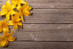 Orange lily on wooden background Stock Photography