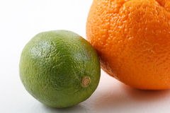 Orange and lime. On white Stock Photos