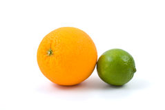 Orange and lime. Isolated on the white background Stock Images