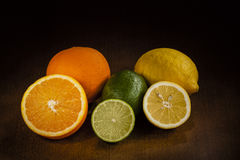 Orange, Lime and Lemon. Fruits cut in half: Orange, Lime and Lemon Royalty Free Stock Photo