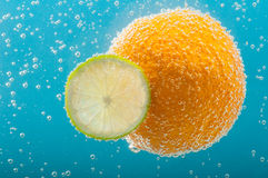 Orange and lime slice in bubbles water Stock Photo