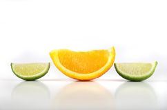 Orange and lime slices. Fresh cut orange and lime slices Royalty Free Stock Photo