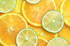 Orange and lime slices background Royalty Free Stock Images