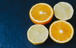Orange And Limon. On dark background Royalty Free Stock Photo