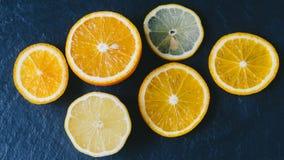 Orange And Limon. On dark background Royalty Free Stock Photos