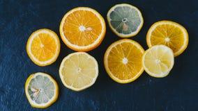 Orange And Limon. On dark background Royalty Free Stock Images