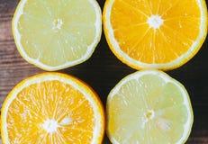 Orange And Limon. On dark background Stock Images