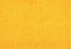 Orange linen background. Stock Image