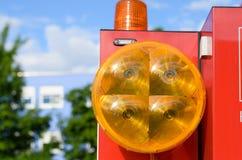 Orange lins på en stor rund lampa Royaltyfri Foto