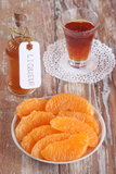 Orange liqueur and tangerine slices. On wooden table Stock Photos