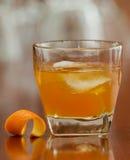 Orange liquor on the rocks Stock Photography