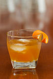 Orange liquor on the rocks Stock Photography