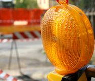 Orange lit the lamp for the roadworks Stock Image