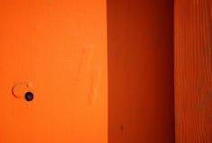 Orange little door Royalty Free Stock Photo