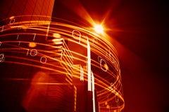 Orange ljusa strålar över skyskrapor Arkivfoto
